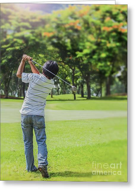 Golfing Photographs Greeting Cards - Male golf player teeing-off golf ball Greeting Card by Anek Suwannaphoom