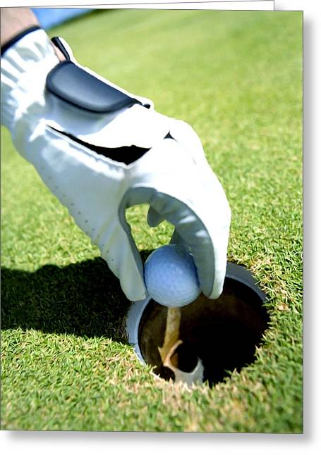 Putt Out Greeting Cards - Male hand picking golf ball out of hole Greeting Card by Lanjee Chee