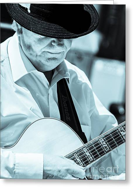 Playing Musical Instruments Greeting Cards - Male In Alpine Hat Playing Guitar Greeting Card by Peter Noyce