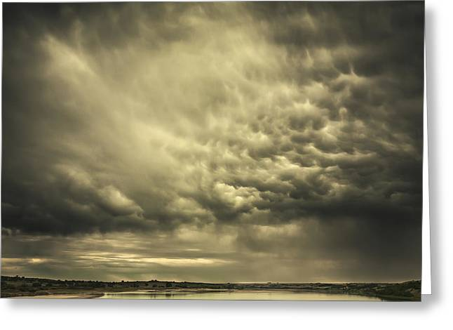 Calming The Storm Greeting Cards - Mammatus Storm Clouds Above A Lake Greeting Card by Joel Koop