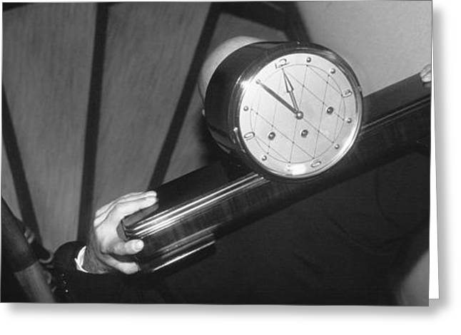 Concept Photographs Greeting Cards - Man Carrying Clock Up Stairs On Greeting Card by Panoramic Images