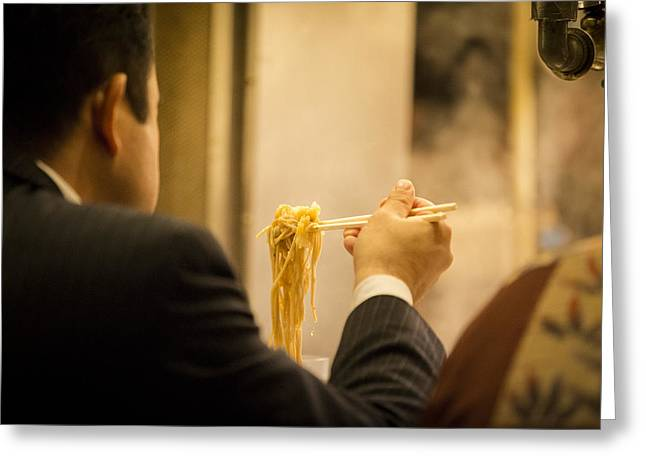 Man eating noodles in a restaurant Greeting Card by Ruben Vicente