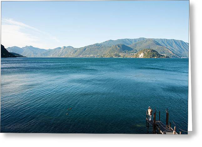 One Man Only Greeting Cards - Man Fishing From Dock On Edge Of Lake Greeting Card by Panoramic Images