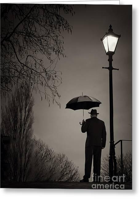 Streetlight Greeting Cards - Man Holding An Umbrella Under A Victorian Street Light Greeting Card by Lee Avison