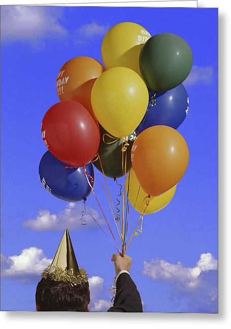Festivities Greeting Cards - Man Holding Balloons And Party Hat Greeting Card by Don Hammond