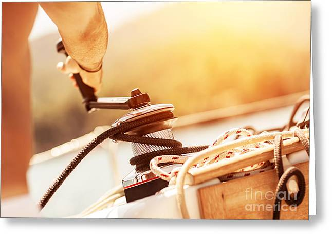 Pull Cord Greeting Cards - Man holding crank on the yacht Greeting Card by Anna Omelchenko