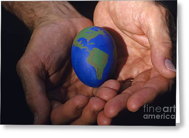 Emotional Knowledge Greeting Cards - Man holding earth egg Greeting Card by Jim Corwin