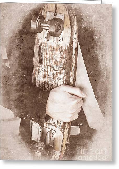 Antique Skates Photographs Greeting Cards - Man holding skateboard Greeting Card by Ryan Jorgensen