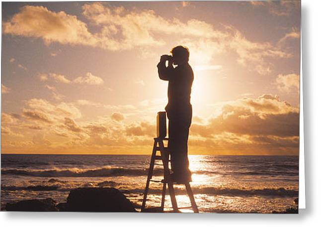 Surreal Landscape Photographs Greeting Cards - Man Looking Through Binoculars In Greeting Card by Panoramic Images