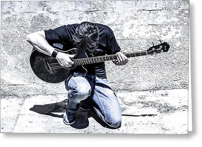 Playing Musical Instruments Greeting Cards - Man Playing Acoustic Guitar Kneeling Outside Greeting Card by Peter Noyce