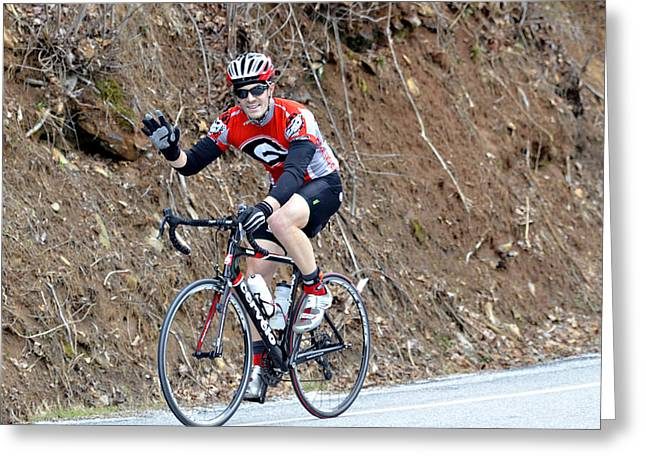 Man Riding Bike in a Race Greeting Card by Susan Leggett