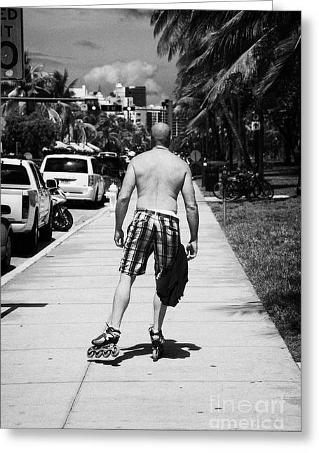 Roller Blades Greeting Cards - Man Rollerblading Along Ocean Drive Early Morning Art Deco District Miami South Beach Florida Usa Greeting Card by Joe Fox