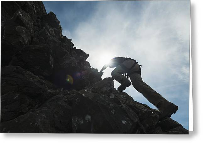 World Of Appearances Greeting Cards - Man Scrambling Up Ridge In The Black Greeting Card by Ian Cumming