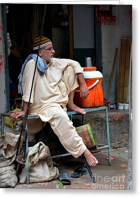 Cloth Greeting Cards - Man sits and relaxes in Lahore walled city Pakistan Greeting Card by Imran Ahmed