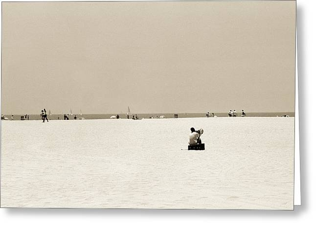 Man sitting on a beach playing his horn Greeting Card by Stephen Spiller
