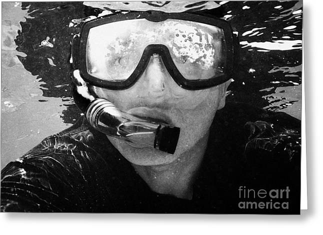 man snorkeling with mask and snorkel in clear water dry tortugas florida keys usa Greeting Card by Joe Fox