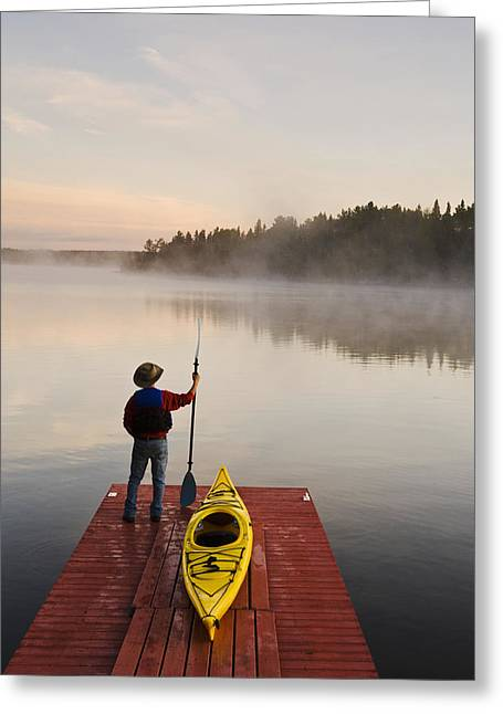 55-59 Years Greeting Cards - Man Standing By Kayak On Dock In Greeting Card by Dave Reede