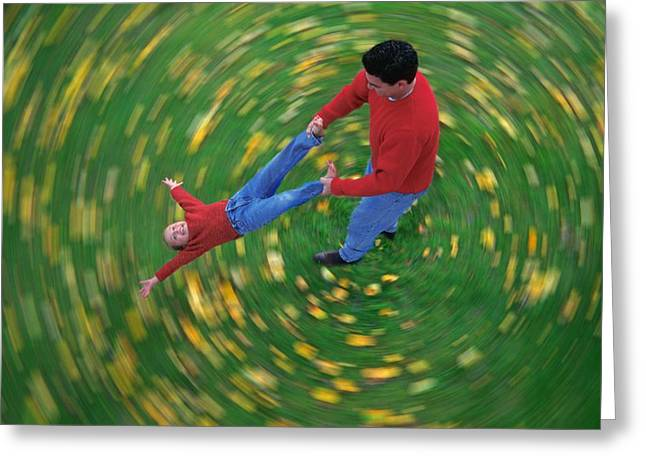 Rotate Greeting Cards - Man Swinging Child Through Air Greeting Card by Don Hammond