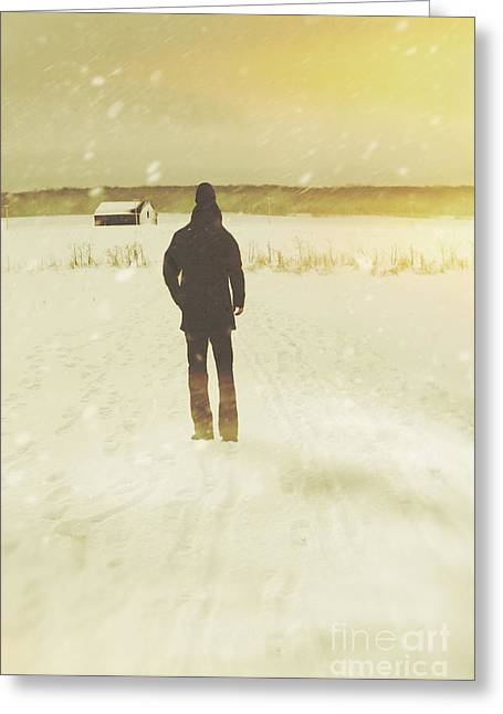 Snow-covered Landscape Greeting Cards - Man walking in snow storm towards a barn Greeting Card by Sandra Cunningham