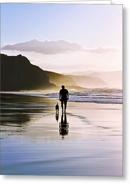 Pais Vasco Greeting Cards - Man Walking The Dog On Beach Greeting Card by Mikel Martinez de Osaba