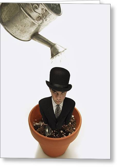 Visual Metaphor Greeting Cards - Man Wearing Suit In Flower Pot About To Greeting Card by Darren Greenwood