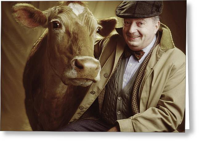 Petcare Greeting Cards - Man With Cow Greeting Card by Ken  Tannenbaum