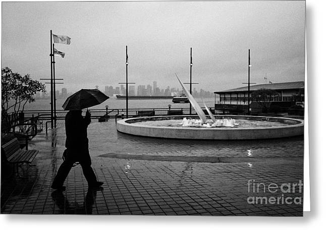 North Vancouver Greeting Cards - man with umbrella walking towards seabus terminal in the rain north Vancouver BC Canada Greeting Card by Joe Fox