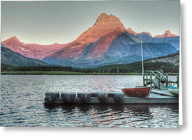 Docked Boat Greeting Cards - Many Glacier boat dock Greeting Card by Linda Covino