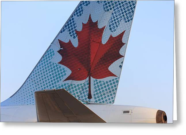 Star Alliance Airline Photographs Greeting Cards - Maple Leaf Logo on Air Canada Airbus 319 Greeting Card by Andrei Filippov