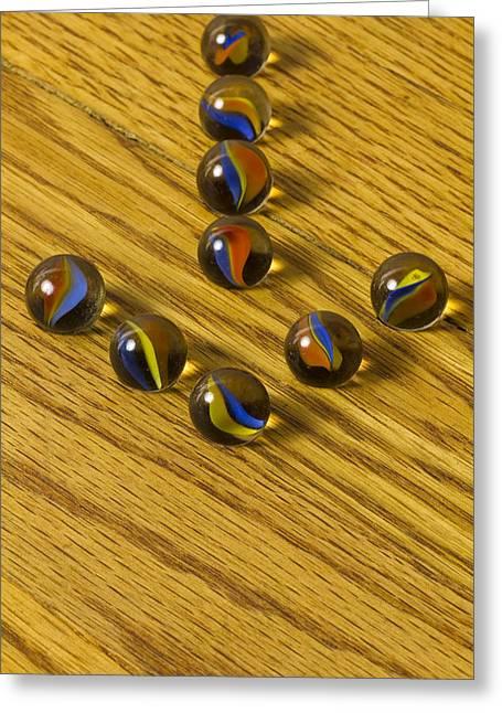 Marble Eye Greeting Cards - Marbles Arrow Cat Eye 1 Greeting Card by John Brueske