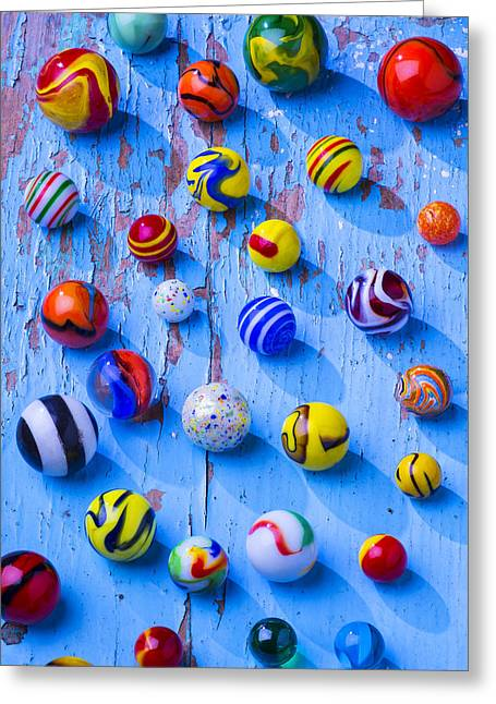 Amusements Greeting Cards - Marbles on blue board Greeting Card by Garry Gay
