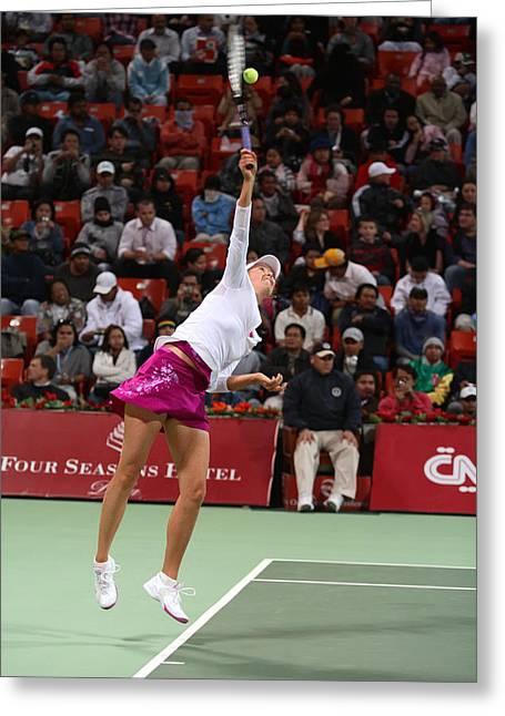 Centre Court Greeting Cards - Maria Sharapova serves in Doha Greeting Card by Paul Cowan