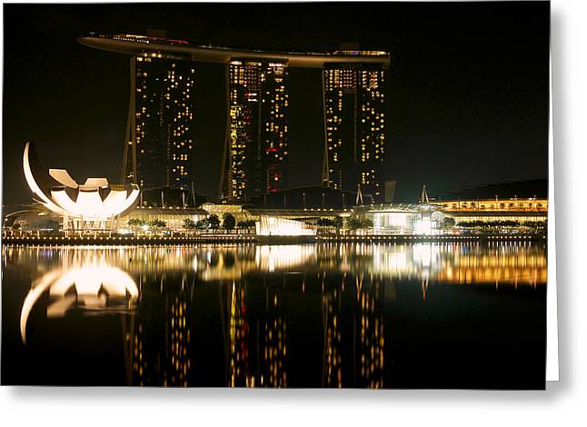 Marina Bay Sands And The Artscience Museum From Across Marina Bay At Night Greeting Card by Chris Quek