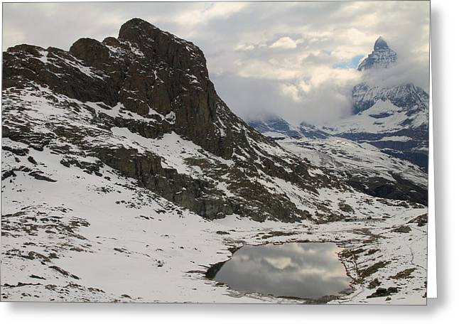 Matterhorn shrouded in clouds Greeting Card by Jetson Nguyen