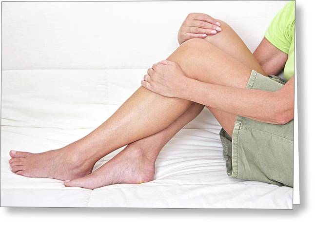 Mature Woman Holding Legs Greeting Card by Lea Paterson