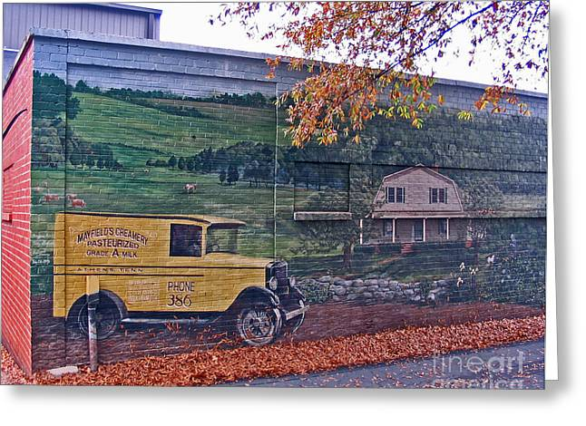 Mayfield Greeting Cards - Mayfield Dairy Mural of Landscape with Yellow Delivery Truck and Barn Painted on Side of Building Greeting Card by Marian Bell