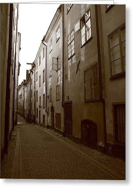 Buildings And Narrow Lanes Greeting Cards - Medieval street in Stockholm - monochrome Greeting Card by Intensivelight