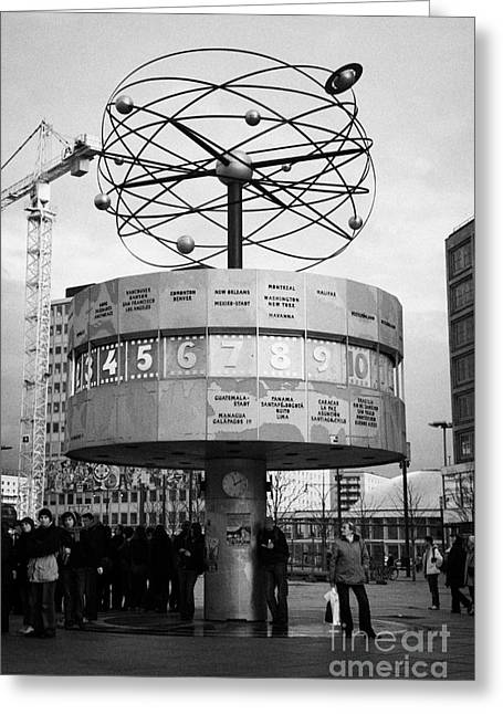 Berlin Germany Greeting Cards - meeting place at the world clock Weltzeituhr at Alexanderplatz with reconstruction work in background east Berlin Germany Greeting Card by Joe Fox