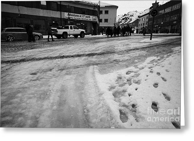 melting ice and snow on street surface holmen Honningsvag finnmark norway europe Greeting Card by Joe Fox