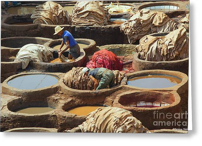 Arabian Pastels Greeting Cards - Men dying sheep hides in stone vessels Greeting Card by Patricia Hofmeester