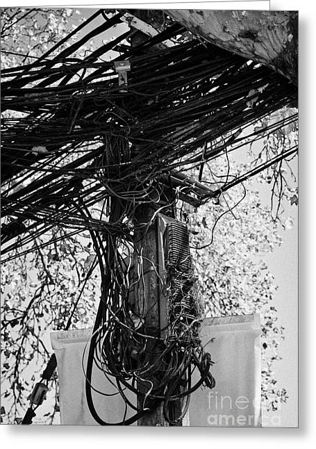 Untidy Greeting Cards - messy open telephone and electricity cables wires on pole in downtown Santiago Chile Greeting Card by Joe Fox