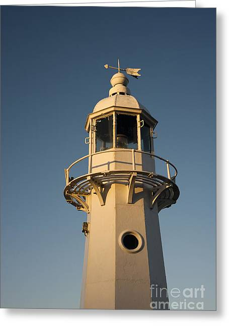 Head Harbour Lighthouse Greeting Cards - Mevagissey Lighthouse in the Evening Greeting Card by Anne Gilbert