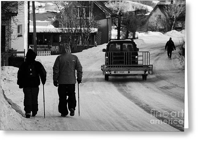 Older Couple Greeting Cards - Middle Aged Couple Walking Along Snow Covered Street With Sticks Kirkenes Finnmark Norway Europe Greeting Card by Joe Fox