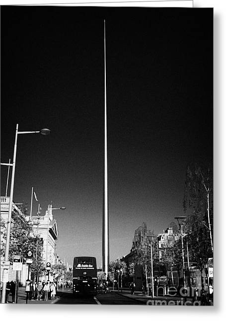 Erection Greeting Cards - millennium needle spire of dublin monument of light and dublin bus in road in OConnell Street Dublin Greeting Card by Joe Fox