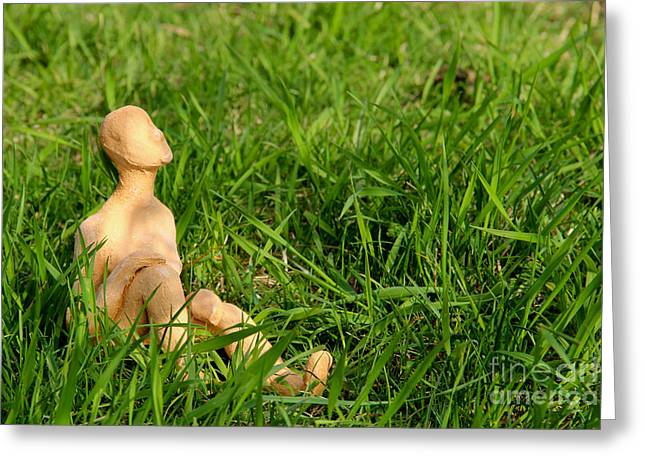 Doll Sculptures Greeting Cards - Miniature figure tanning in the green grass Greeting Card by Kerstin Ivarsson