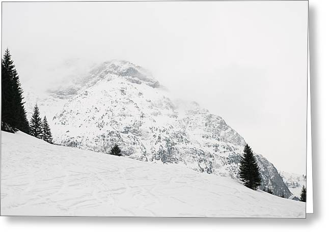 Snow-covered Landscape Greeting Cards - Minimalist snow landscape - mountain and trees in winter Greeting Card by Matthias Hauser
