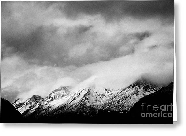 Snow-covered Landscape Greeting Cards - mist rolling over snow covered patagonian mountains from Ushuaia Argentina Greeting Card by Joe Fox