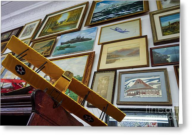 Hand Greeting Cards - Model airplanes near wall of framed artwork  Greeting Card by Amy Cicconi