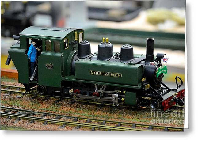 Jack Kent Greeting Cards - Model train green steam railway engine with driver in cab Greeting Card by Imran Ahmed
