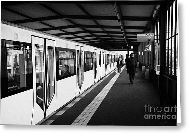 Berlin Germany Greeting Cards - modern yellow u-bahn train sitting at station platform Berlin Germany Greeting Card by Joe Fox